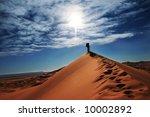 Man in sand desert - stock photo