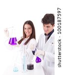 Team of young scientists at laboratory - stock photo