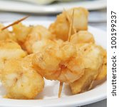 closeup of a plate with battered and fried shrimps served as tapas - stock photo