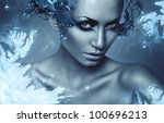 cold winter woman with splash on eyes - stock photo