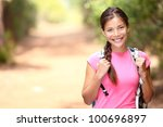 Hiker woman. Hiking portrait of happy young female hiker smiling looking at camera. - stock photo