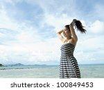 Asian Women smile on the Beach - stock photo