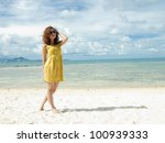 Asian Women on the Beach with vibrant yellow dress - stock photo