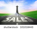 A road turning into an arrow rising upward symbolizing growth and improvement of sales - stock photo