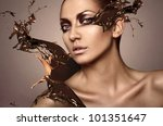 portrait of woman with chocolate splash - stock photo
