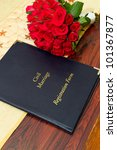 Civil marriage registration form with red roses - stock photo