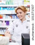The pharmacist sells the medicine in a pharmacy - stock photo
