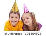 Happy kids with party hats - isolated - stock photo