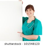 overweight woman doctor showing somethink on the blank sign, white background - stock photo