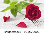 table setting for valentine with fork and rose - stock photo