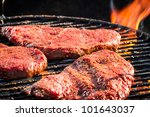 Steak on grill fire-toasted - stock photo