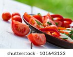 Healthy salad with tomatoes in the garden - stock photo