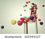 colored balls falling down isolated on white background - stock photo