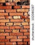 Background of a detailled red brick wall - stock photo