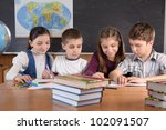 Group of pupils aged 11 study at classroom - stock photo