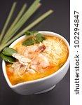 Thai shrimp soup bowl with nice garnish. - stock photo