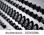 audio inputs on the back of a soundboard mixer - stock photo