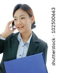 Asia yong businesswoman working on phone - stock photo