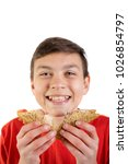 Young caucasian teenage boy eating a sandwich - stock photo