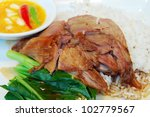 Stewed pork with cooked rice and egg on dish - stock photo