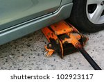 Jacking up a car with the emergency jack - stock photo