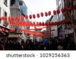London, United Kingdom, 18th Febuary 2018:- Crowds enjoying the festivities to celebrate Chinese New Year in London's Chinatown area and surrounding streets, for the year of the dog 2018 - stock photo