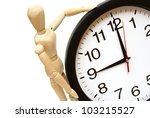 A mannequin and clock are on white to represent time management. - stock photo