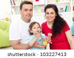 Young family with toddler child together at home - stock photo