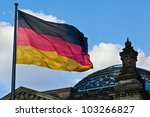 German Reichstag dome with the German national flag - stock photo