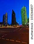view of the office towers at the Potsdamer Platz in Berlin with blue night sky - stock photo