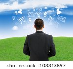 Businessman outdoor with business symbols - stock photo