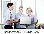 Young doctor with two attractive nurses - stock photo