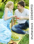 Portrait of a young couple in the outdoors with glasses of wine - stock photo