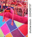 Colorful straw bags in a sunny day ready for sale at a street market, France - stock photo