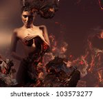 sexy erotic nude woman in burning ashes - stock photo