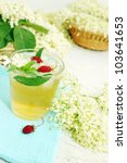 A cold refreshing summer drink made from elder flowers and strawberries - stock photo