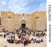 JERUSALEM, ISRAEL - APRIL 12: Damascus Gate - the most visited entrance to Old City of Jerusalem and street market during the Jewish Pesach (Passover) on April 12, 2012 in Jerusalem, Israel - stock photo
