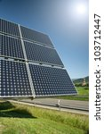 Solar Panel With The Sun Against The Blue Sky - stock photo