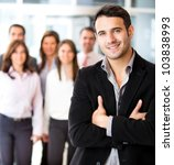 Successful businessman at the office leading a group - stock photo