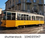 A symbol of the city, the old and traditional orange tram in Milan, Lombardy, Italy - stock photo