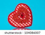 red decorative heart with reflection on blue background - stock photo