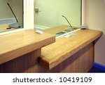 Office reception counter with glass screen - stock photo