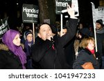 Downing Street, London, United Kingdom, 07th March 2018:- Unknown Protester addresses the crowd outside Downing Street against the visit to the UK by the crown prince of Saudi Arabia - stock photo