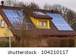 Solar panels on a colorful modern house - stock photo