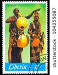 LIBERIA - CIRCA 1967: A stamp printed in Liberia shows Alimilim series Local Music, circa 1967 - stock photo