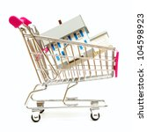 A house sits inside a shopping cart for real estate concepts. - stock photo