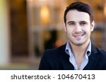 Portrait of a handsome casual businessman smiling - stock photo
