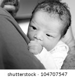 Newborn baby girl and father. Child abuse concept. - stock photo