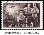 HUNGARY- CIRCA 1951: A stamp printed by Hungary, shows tractor manufacture, circa 1951 - stock photo