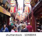 Typical City Street in China.  Shanghai has block after block of stores and shops just like these with tourists galore - stock photo